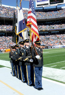 Fort Carson's John Briggs, second in line, and Daniel Breneman, fourth in line, were part of the Colorado Army National Guard Honor Guard that performed flag posting ceremonies before the beginning of military appreciation activities at Invesco Field at Mile High in Denver Sunday.