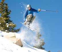 Photo by Trevor McConnell, Outdoor Recreation.  A skier gets some air while skiing powder at Monarch Mountain resort.