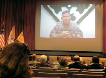 Maj. Gen. David G. Perkins, commanding general, U.S. Division-North and 4th Infantry Division, addresses the audience in McMahon Auditorium during a video teleconference March 10.