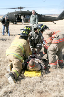 "Photos by Spc. Samantha B. Koss.  Fort Carson firefighters medevac an ""injured"" Soldier during the April 6 exercise."