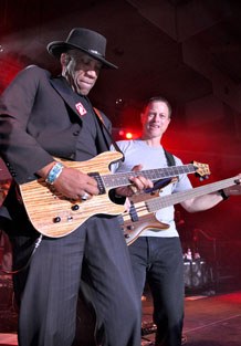 Founding members of the Lt. Dan Band, Kimo Williams, left, and Gary Sinise, rip into a dual guitar solo April 8 at the Special Events Center.
