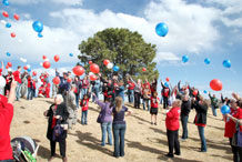 Survivors of fallen servicemembers release helium-filled balloons outside the Elkhorn Conference Center Saturday, following a peer support seminar hosted by the Tragedy Assistance Program for Survivors. Almost half of the participants had their lives altered by a combat-related death; others spoke about a suicide, traffic accident or sudden illness.