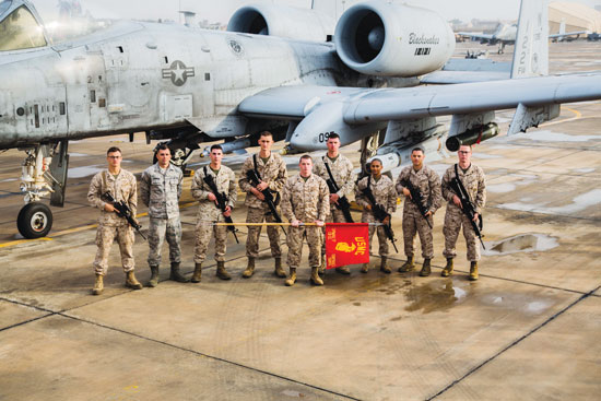 (Courtesy photo) Senior Airman Nathan Bowman, 21st Force Support Squadron (second from left), is conspicuous in his Air Force uniform as he stands among fellow graduates of the Marine Corporals Leadership Course. Bowman and one other Airman were admitted to the course, which is not typical, according to Marine 1st Sgt. Jason Politte, who ran the course. Bowman attended the course Jan. 25-Feb. 19 while deployed to Southwest Asia.