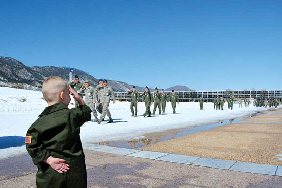 U.S. Air Force photo Elijah Yeomans salutes U.S. Air Force Academy cadets March 6, 2015, at Colorado Springs, Colo. Yeomans became the youngest cadet for a day as part of a program that is designed to honor local children and families struggling to overcome serious physical challenges.