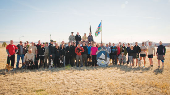 (U.S. Air Force photo illustration by Staff Sgt. J. Aaron Breeden) PETERSON AIR FORCE BASE, Colo. -- A group of tactical air control party Airmen from the 13th Air Support Operations Squadron and their spouses pose for a photo at the conclusion of the fourth annual 24-hour Tactical Air Control Party Awareness Run at Peak View Park on Peterson AFB, March 26. The purpose of the run was to raise awareness and generate donations for the TACP Association. The money generated by this event helps to support the families of fallen TACP members as well as disabled TACP Airmen.