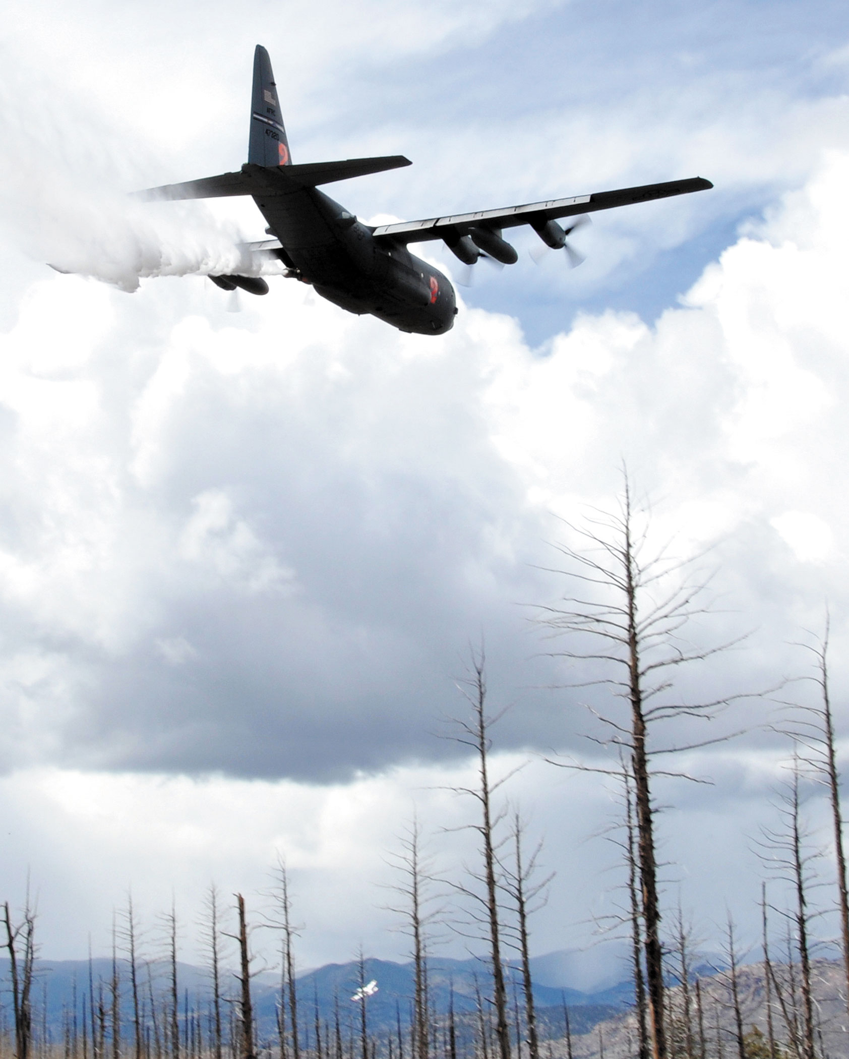 (U.S. Air Force photo/Master Sgt. Daniel Butterfield) A Modular Airborne Fire Fighting System-equipped C-130 from the Air Force Reserve's 302nd Airlift Wing drops potable water near Hackett mountain in Pike National Forest, Colo. during MAFFS certification training, May 16, 2015. Retardant dropped from a MAFFS-equipped C-130 can cover an area one-quarter of a mile long and 100 feet wide to aid in the containment of wildland fires.