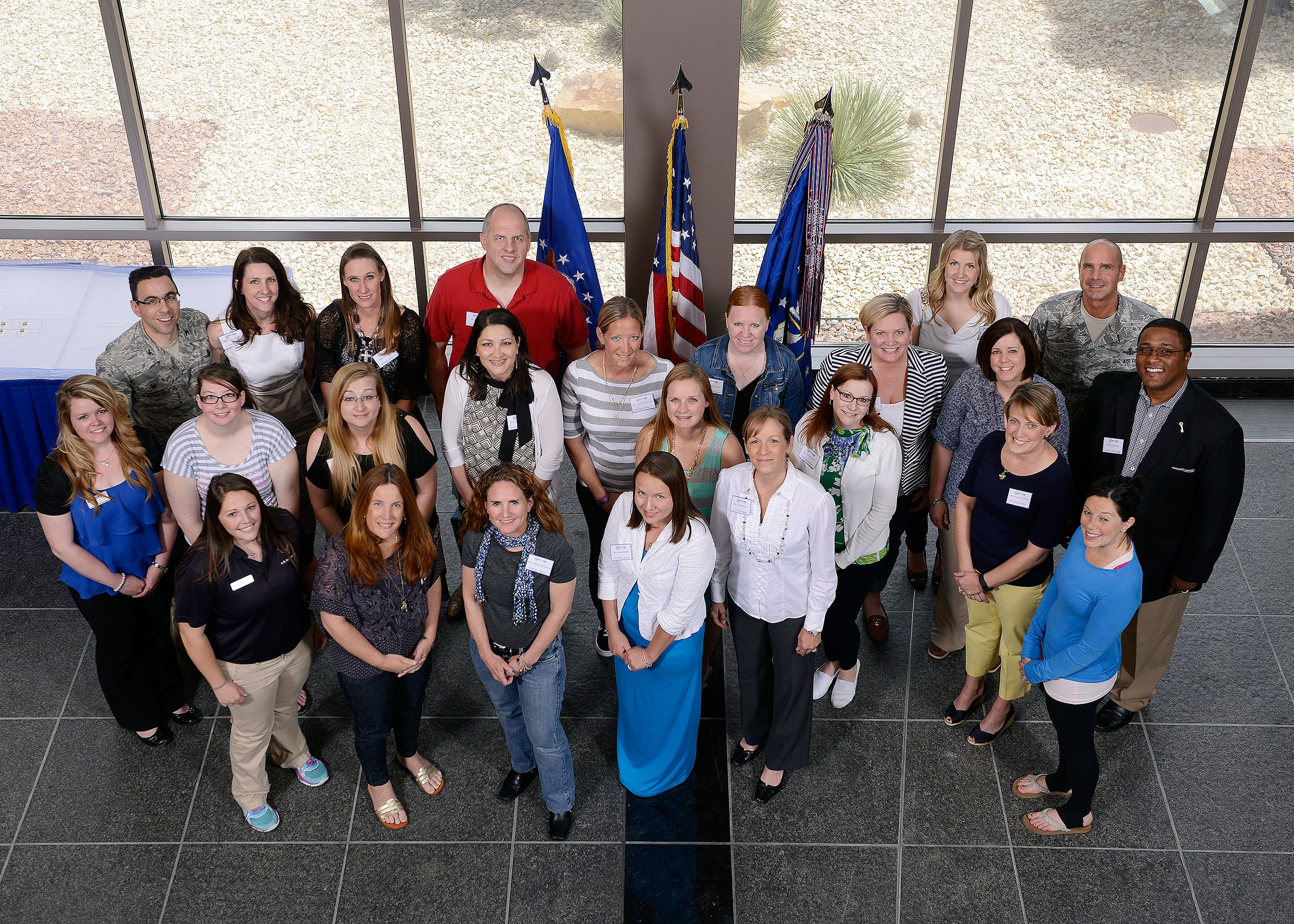 U.S. Air Force photo/Christopher DeWitt Col. Bill Liquori 50th Space Wing commander, left, and Chief Master Sgt. John Bentivengna, 50 SW command chief, stand with key spouses following a luncheon Friday at Schriever Air Force Base, Colo. Liquori held the luncheon, and presented each key spouse with a certificate and token of appreciation, as a way to say thank you to the all-volunteer group. In Liquori's two years as commander, the program has grown from a group of 11 volunteers to 64, with each squadron having at least one key spouse.