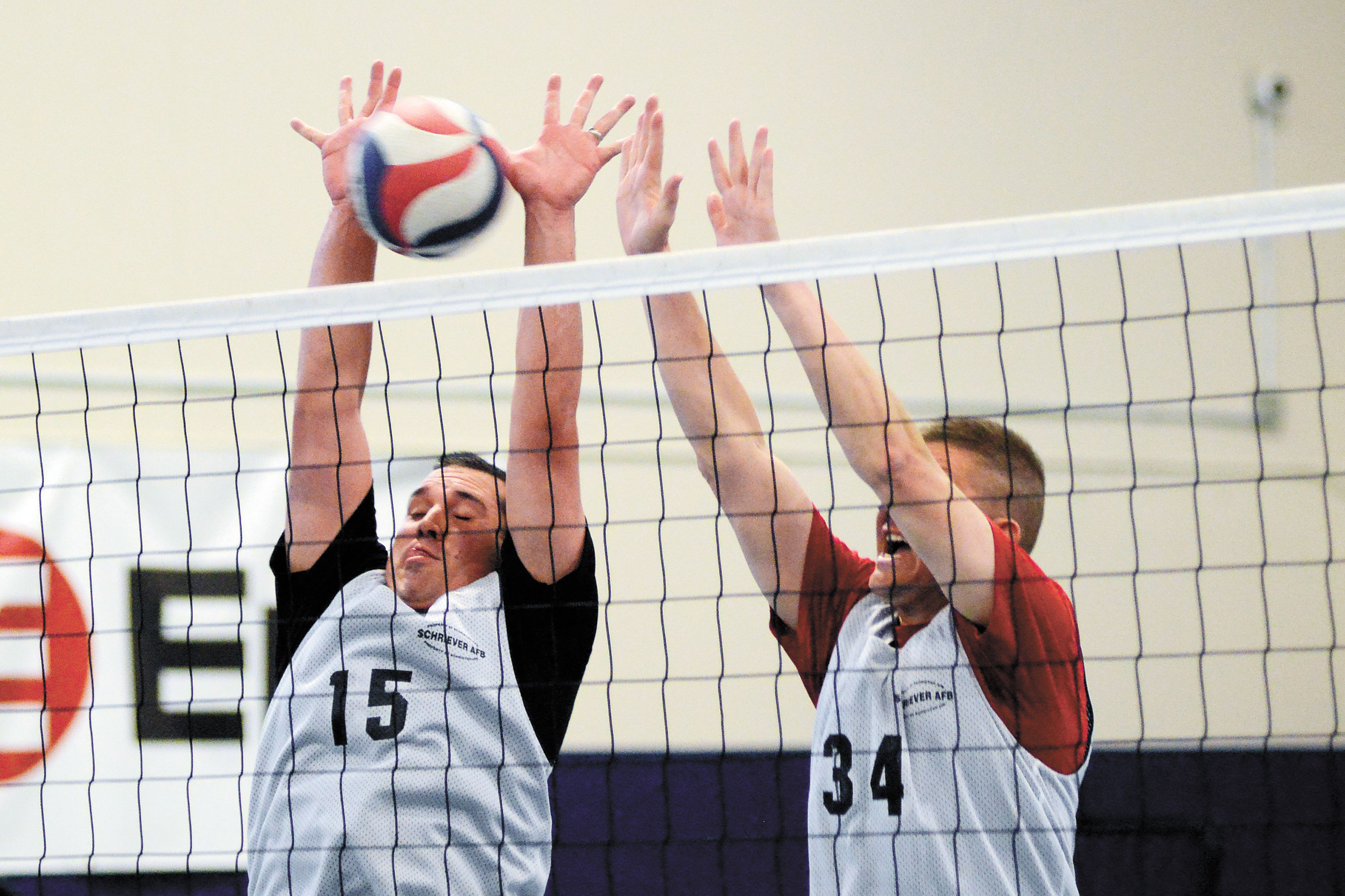 U.S. Air Force photo/Christopher DeWitt Eric Lewandowski, left, and John Thien, United States Air Force Warfare Center, go up for a block during the intramural volleyball championship game Thursday in the fitness center gym at Schriever Air Force Base, Colo. USAFWC defeated the 6th Space Operations Squadron 25-20 and 25-22 to win the title. U.S. Air Force photo/Christopher DeWitt Eric Lewandowski, left, and John Thien, United States Air Force Warfare Center, go up for a block during the intramural volleyball championship game Thursday in the fitness center gym at Schriever Air Force Base, Colo. USAFWC defeated the 6th Space Operations Squadron 25-20 and 25-22 to win the title.