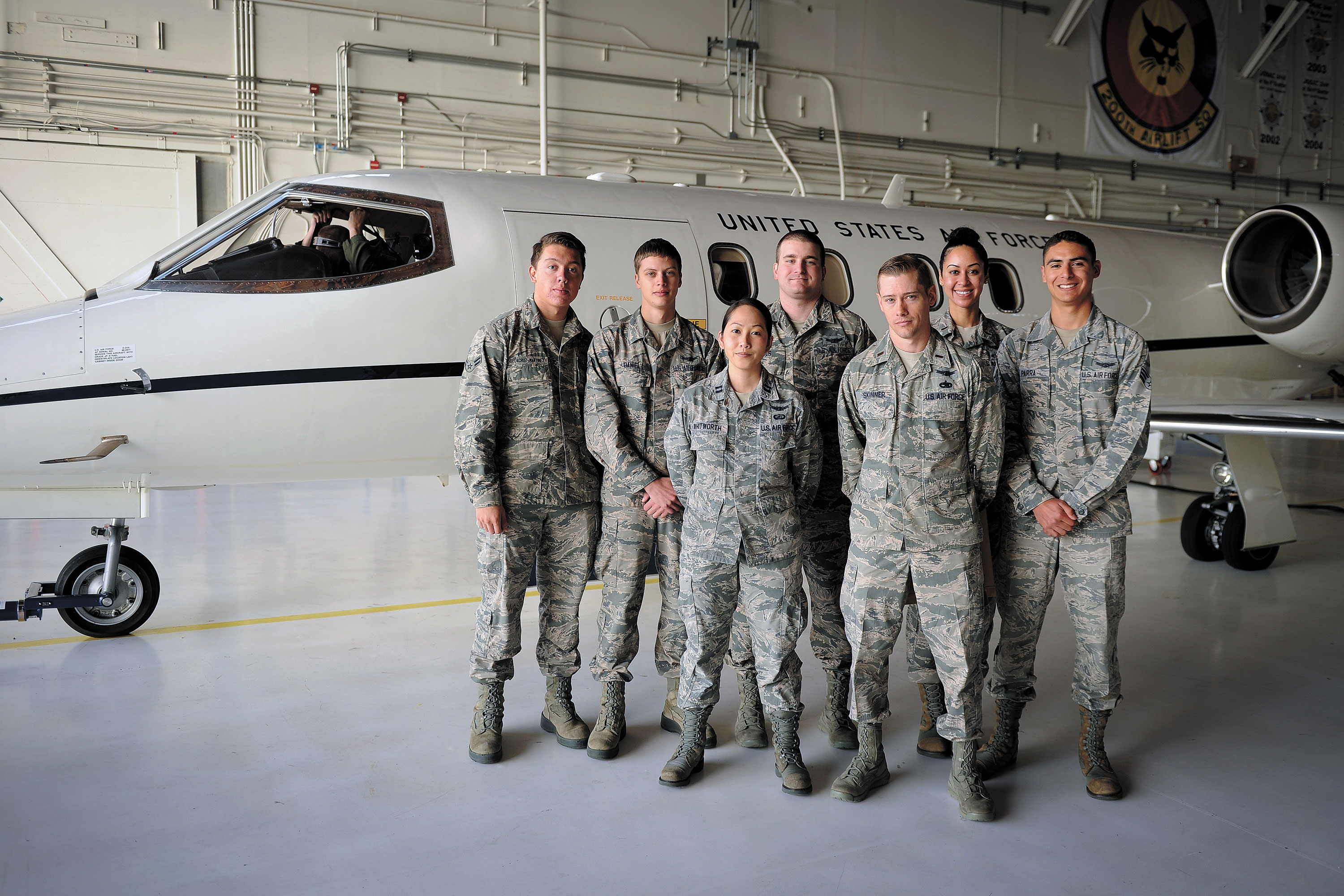 U.S. Air Force photo/Dennis Rogers Members of the 2nd Space Operations Squadron pose at Peterson Air Force Base, Colorado, before boarding a flight to their Alternate Master Control Station to complete a transfer operation June 5, 2015. 2 SOPS traveled to validate its abilities to carry out the mission of GPS command and control at its backup site there.