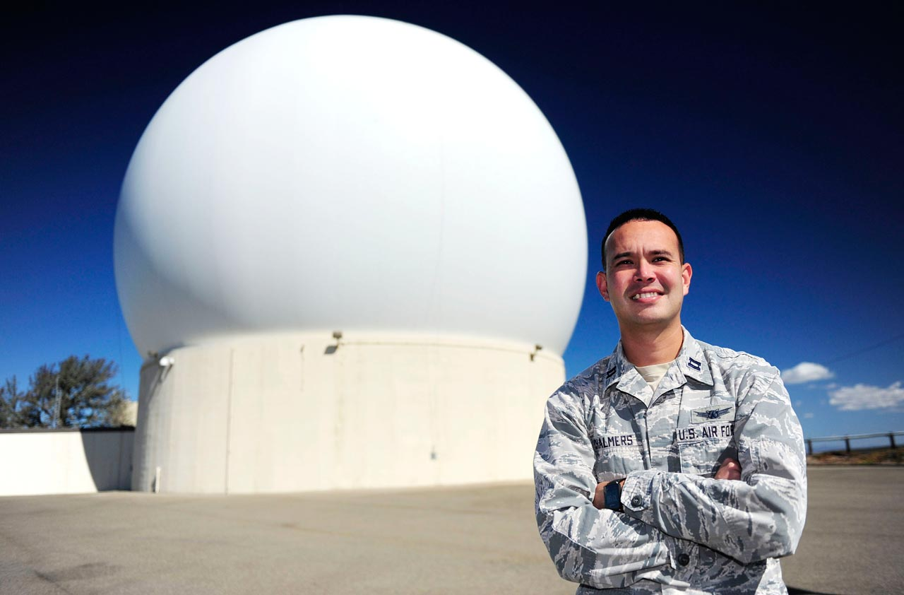 U.S. Air Force photo/Staff Sgt. Jim Araos Capt. Joel Chalmers, Vandenberg Tracking Station flight commander, stands in front of a radome, Friday, Oct. 2, 2015, at COOK, one of seven Air Force Satellite Control Network around the world. The AFSCN performs telemetry, tracking and commanding functions for 175 satellites in support of more than 10 Department of Defense and national organizations.