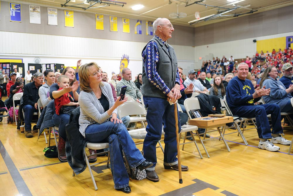 U.S. Air Force photo/Dennis Rogers Ed Keefer, a World War II veteran, stands as he receives a round of applause during the annual Veterans Day recognition ceremony at Ellicott High School in Ellicott, Colorado, Wednesday, Nov. 11, 2015. Keefer is a 93-year-old veteran who served as an infantryman with the 10th Mountain Division.