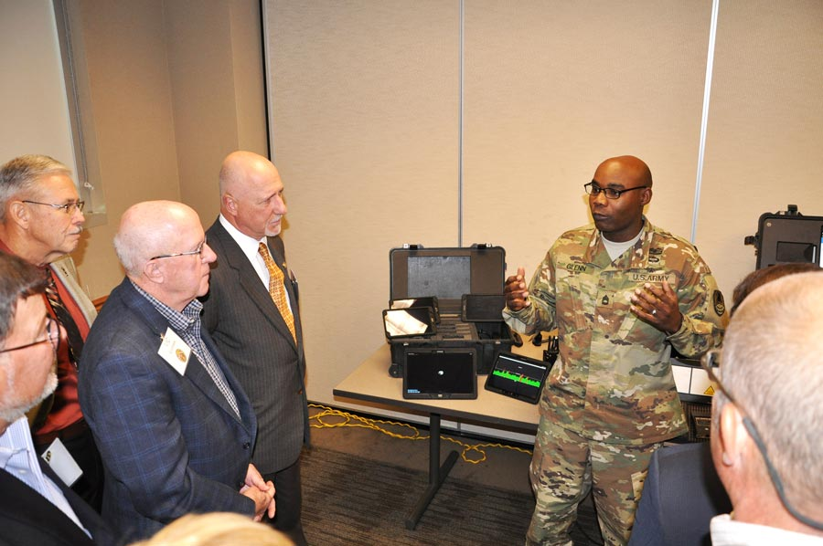 (Photo by Dottie White) PETERSON AIR FORCE BASE, Colo. — Sgt. 1st Class Paul Glenn, operations sergeant, U.S. Army Space and Missile Defense Command/Army Forces Strategic Command, explains some of the uses of space kits to the Colorado Thirty Group during a visit to the command's Colorado Springs headquarters Oct. 27.