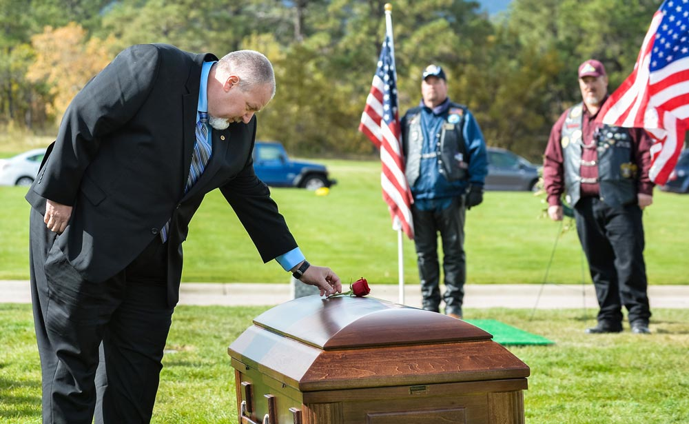 (U.S. Air Force photo by Liz Copan) Dave Pelky lays a rose on the casket of wife Maj. Phyllis Pelky Oct. 26, 2015 at the U.S. Air Force Academy Cemetery. Funeral services for the major, a former German language instructor and aide-de-camp to Academy Superintendent Lt. Gen. Michelle D. Johnson, were held in the Cadet Chapel. Phyllis Pelky died Oct. 11, 2015 in a helicopter accident while deployed to Afghanistan. Dave and Phyllis Pelky were married 25 years.