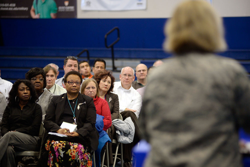 U.S. Air Force Photo/Dennis Rogers Col. DeAnna M. Burt, 50th Space Wing commander, hosts a town hall Monday, Jan. 11, 2016, at Schriever Air Force Base, Colorado. The meeting aimed to present information and address questions regarding the Air Force's Reduction in Force initiative.