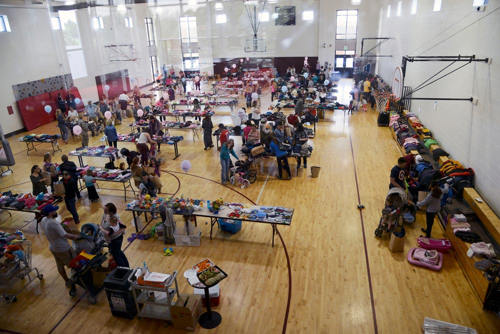 PETERSON AIR FORCE BASE, Colo. — Customers shop for free, donated clothing at the annual clothing swap at the Peterson Youth Center April 23, 2016. Selections ranged from newborn through teenager with maternity clothes and a toy per child also available.