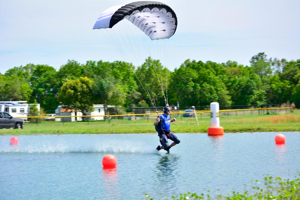 Courtesy photo/Brian Deegan Matthew Shull, 6th Space Operations Squadron, gains points as he drags the water through the accuracy course in Zephyrhills, Florida, April 3, 2016. Shull placed fifth during the United States Parachute Association's National Championships of Canopy Piloting April 8. Canopy piloting is a series of tasks designed to test a parachutist's ability to control his canopy and fly accurately.