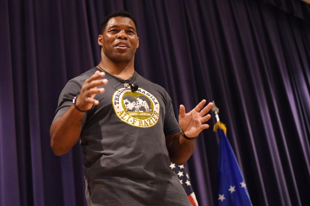 PETERSON AIR FORCE BASE, Colo. — Herschel Walker, retired NFL football player, speaks on resiliency to Team Pete in the base auditorium at Peterson Air Force Base, Colo., June 8, 2016. Walker shared stories of his battle with Dissociative Identity Disorder in hopes to motivate service members to address their problems and get help to overcome them.