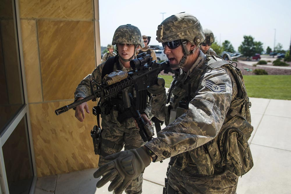 U.S. Air Force Photo/Dennis Rogers Defenders with the 50th Security Forces Squadron prepare to enter a building during an active-shooter exercise at Schriever Air Force Base, Colorado, Thursday, June 16, 2016. The scenario was a part of Opinicus Vista 16-2, a base exercise that tested Team Schriever's readiness to respond during crisis scenarios.
