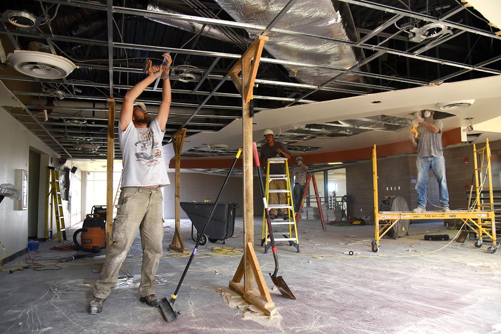 (U.S. Air Force photo by Airman 1st Class Dennis Hoffman) Construction workers remove the ceiling inside the R.P. Lee Youth Center at Peterson Air Force Base, Colo., Aug. 22, 2016. A concern with the ceiling on the second floor of the building arose after the replacement of the building's new roof was completed. Construction is expected to take approximately 30 days.