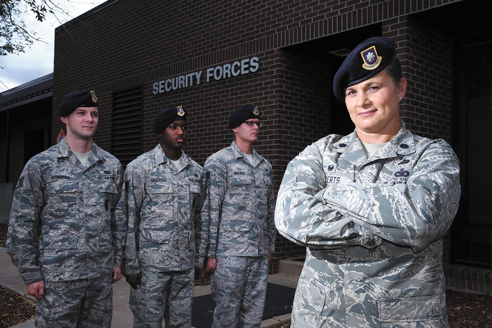 "(U.S. Air Force photo by Airman 1st Class Dennis Hoffman) PETERSON AIR FORCE BASE, Colo. – Lt. Col. Nicole Roberts, 21st Security Forces Squadron commander, relies on a personable leadership style she still uses today to effectively lead her 214 Airmen at Peterson Air Force Base, Colo. Roberts is affectionately known as ""Mama Bear"" around her squadron."