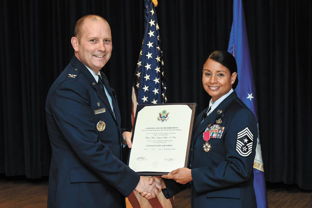 (U.S. Air Force photo by Craig Denton) PETERSON AIR FORCE BASE, Colo. — Chief Master Sgt. Idalia Peele, outgoing 21st Space Wing command chief, receives a certificate of retirement during a ceremony at The Club on Peterson Air Force Base, Colo., Aug. 25, 2016. Peele's military service took her across the world and spanned several different positions throughout more than 29 years in the Air Force.
