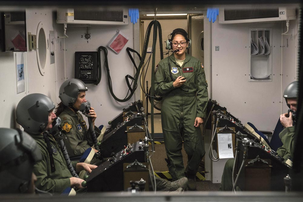 (U.S. Air Force photo by Senior Airman Rose Gudex) PETERSON AIR FORCE BASE, Colo. — Senior Airman Laura Perez, 21st Aerospace Medicine Squadron aerospace and operational physiological technician, briefs pilots and aircrew members from across the nation about the high altitude chamber simulation in December 2015. Perez was born in California, but her parents are from Mexico and El Salvador, both of whom contributed to her dedication to hard work and strong sense of family.