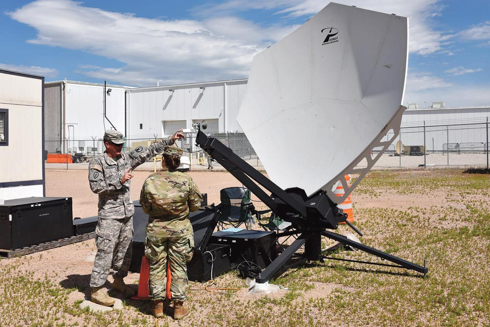 (U.S. Army photo by Dottie White) COLORADO SPRINGS, Colo. — Army Sgt. 1st Class Taylor Michelsen, a space control training instructor with the U.S. Army Space and Missile Defense School House, teaches Spc. Jenna M. Goodwin, 1st Space Brigade, how to determine and adjust the polarization of the Patriot antenna during the Army Space Control Fundamentals course in Colorado Springs, Colo, Aug. 10, 2016.