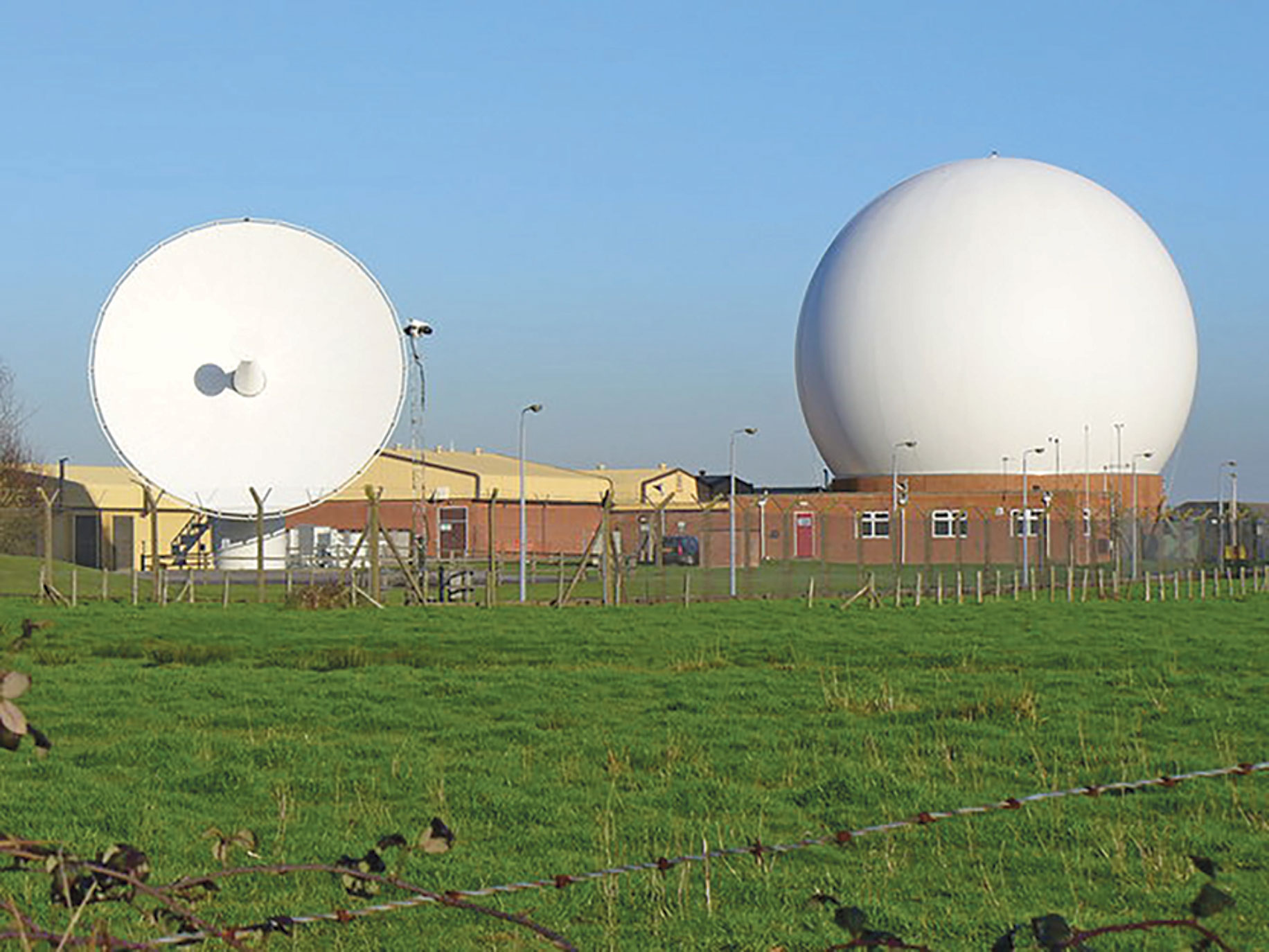 Copyright/Colin Smith A satellite dish and dome jut out along the fence line of Royal Air Force Station Oakhanger, February 2007. A small detachment of the 23rd Space Operations Squadron is located at the station which has three antennas that allow AFSCN users to command, control and track space vehicles.