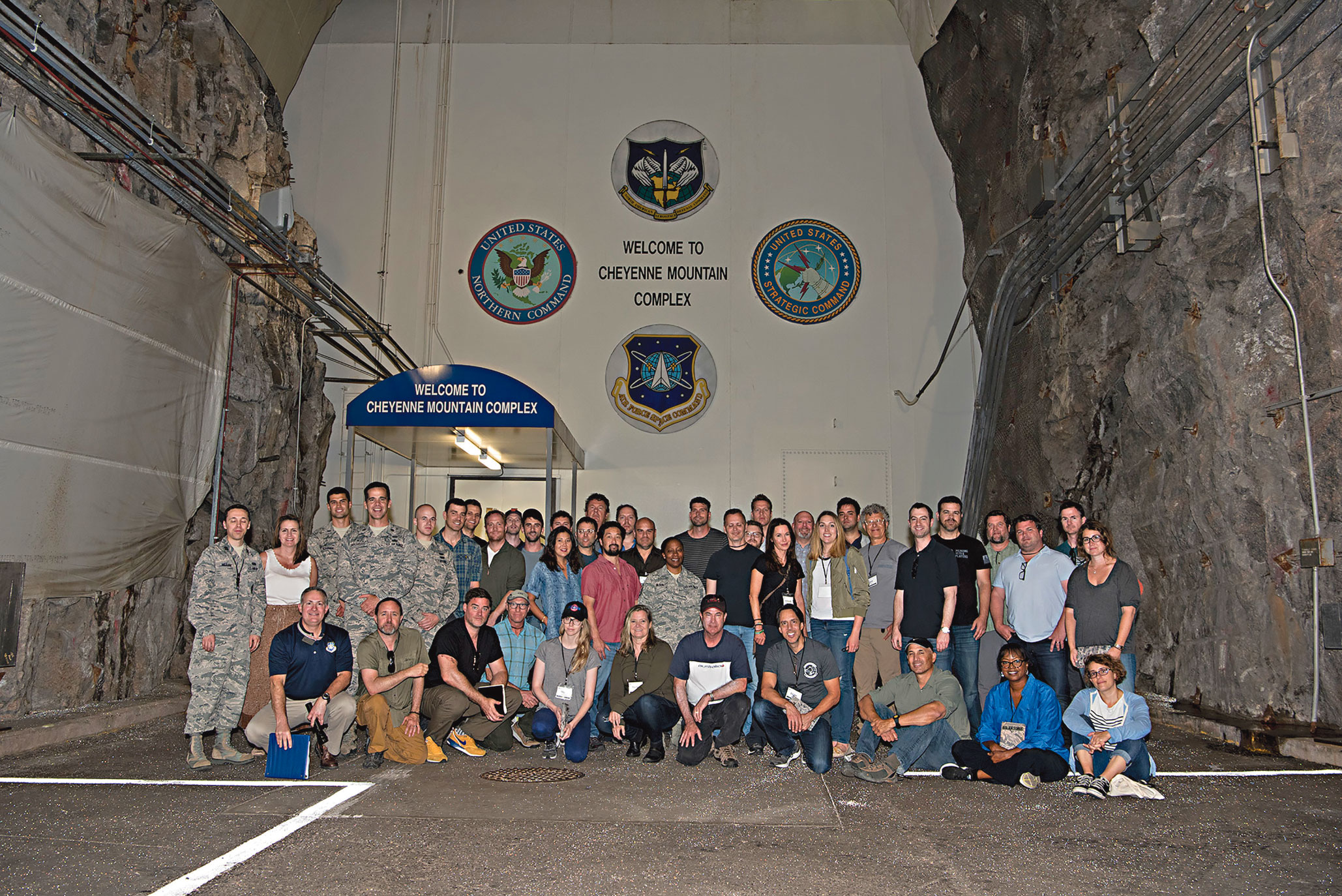 (U.S. Air Force photo by Steve Kotecki) Cheyenne Mountain Air Force Station, Colo. —A group of Hollywood executives visit Cheyenne Mountain Air Force Station, Colo., for a tour of the complex, July 18, 2017. The tour was conducted as part of an outreach program to Hollywood screenwriters, producers and directors in an effort to give Hollywood an inside look into the Air Force space mission and ensure that any projects they produce can be represented accurately.
