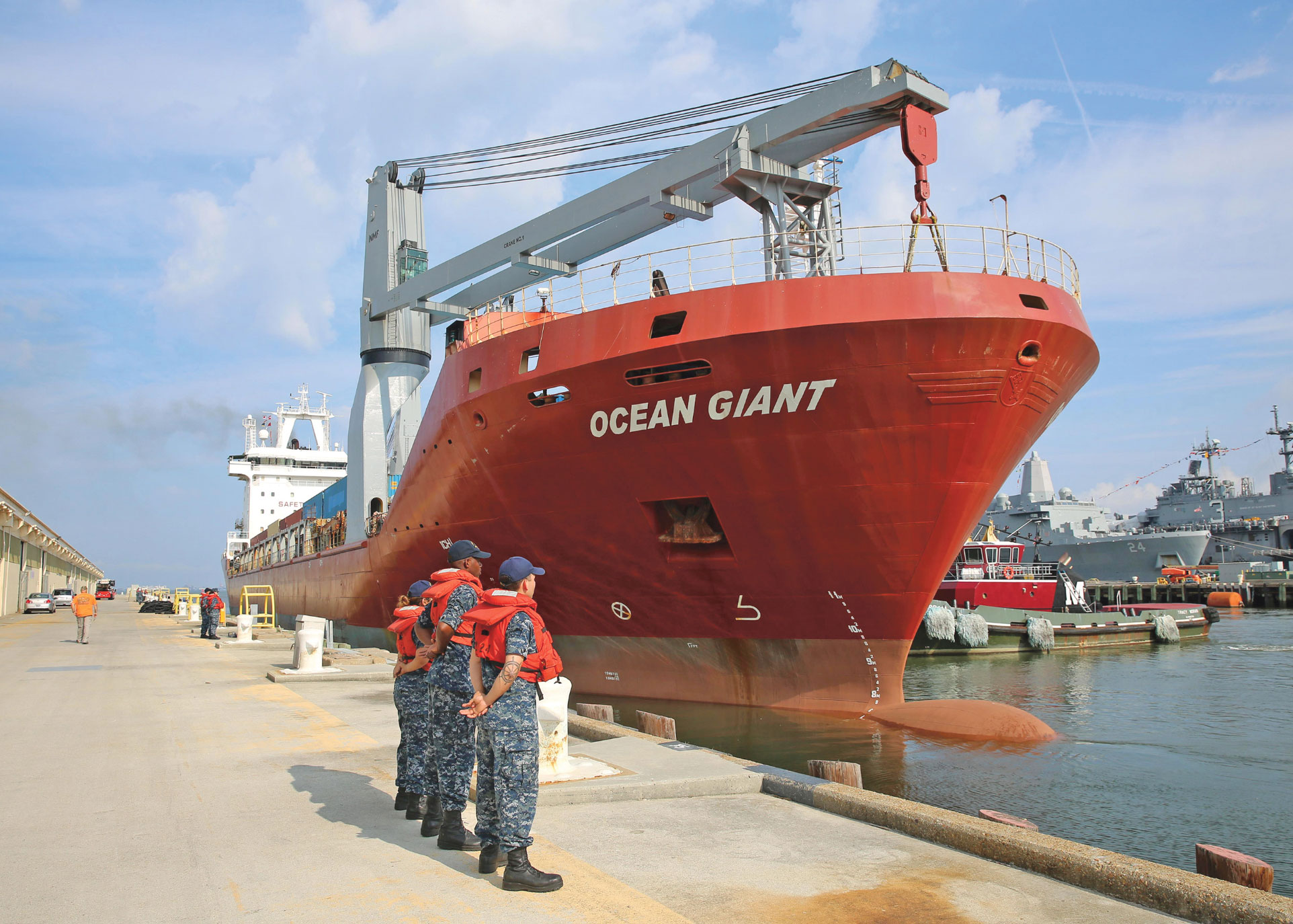 NORFOLK, Va. —U.S. Navy Sailors render honors as the Military Sealift Command contracted ship MV Ocean Giant gets underway from Naval Station Norfolk, July 16. Ocean Giant left Virginia in support of Operation Pacer Goose 2017, the annual resupply mission to Thule Air Base.