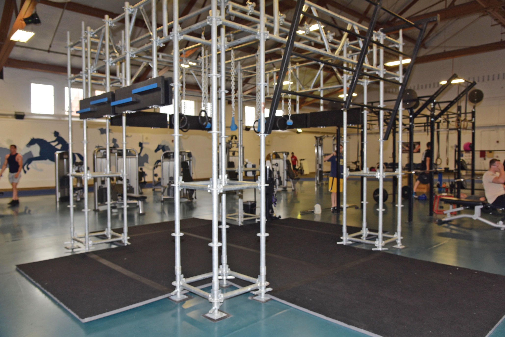 U.S. Air Force photo/2nd Lt. Nikita Thorpe An Air Force Alpha Warrior Battle Rig is stationed in the center of Independence Hall Fitness Center at F.E. Warren Air Force Base, Wyoming, July 8, 2017. The Alpha Warrior Program is an Air Force-wide fitness initiative to incorporate a functional fitness approach in every Airman's mindset and a way to tackle the four pillars of Comprehensive Airmen Fitness.