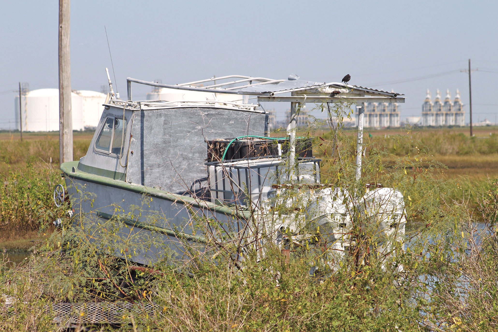 (Courtesy photo) Sabine Pass, Texas — A boat run aground in Sabine Pass, Texas, Sept. 9, 2017, after Hurricane Harvey struck the greater Houston Area in August, 2017. The hurricane initially hit Houston on Aug. 25, 2017, and continued to make landfall two more times before moving back out into the Gulf of Mexico.