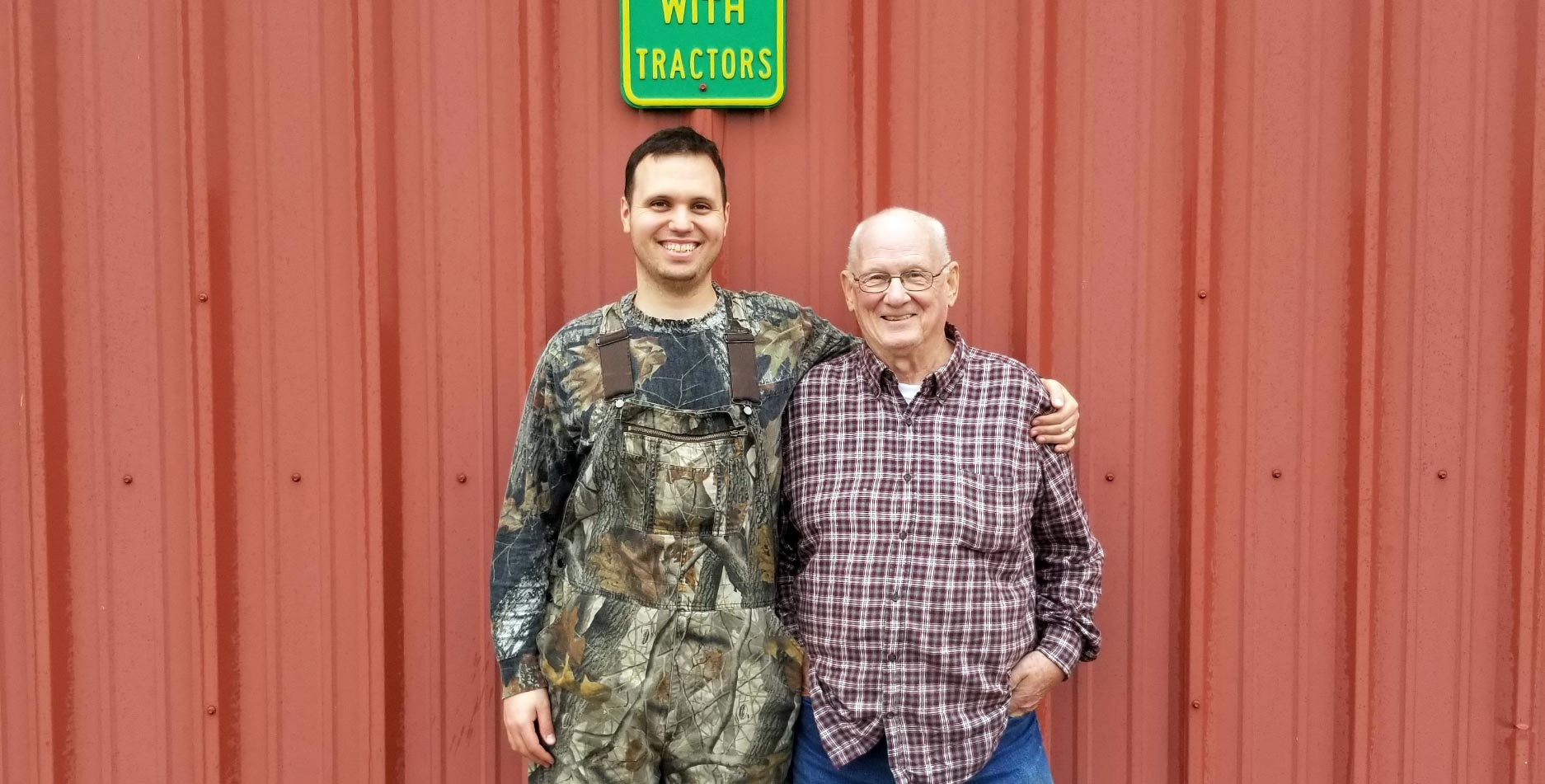 Courtesy photo Senior Airman Michael Fruit, 2nd Space Operations Squadron satellite systems operator, left, and Dan Fruit, Michael's grandfather, smile at their soy bean, wheat and corn farm in Emporia, Kansas, Nov. 14, 2017. The global positioning system has helped increase efficiency and accuracy of planting and cultivating crops at farms like theirs.
