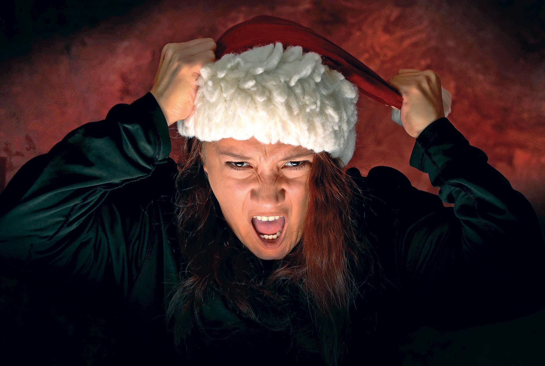 Airman Adrianna Barelas, 4th Space Operations Squadron system administrator, displays her Grinch side for the holiday season at Schriever Air Force Base, Colorado, Dec. 1, 2017. Many things can cause stress during the holidays, including financial strain from gift buying, social pressure and expectations based on tradition.