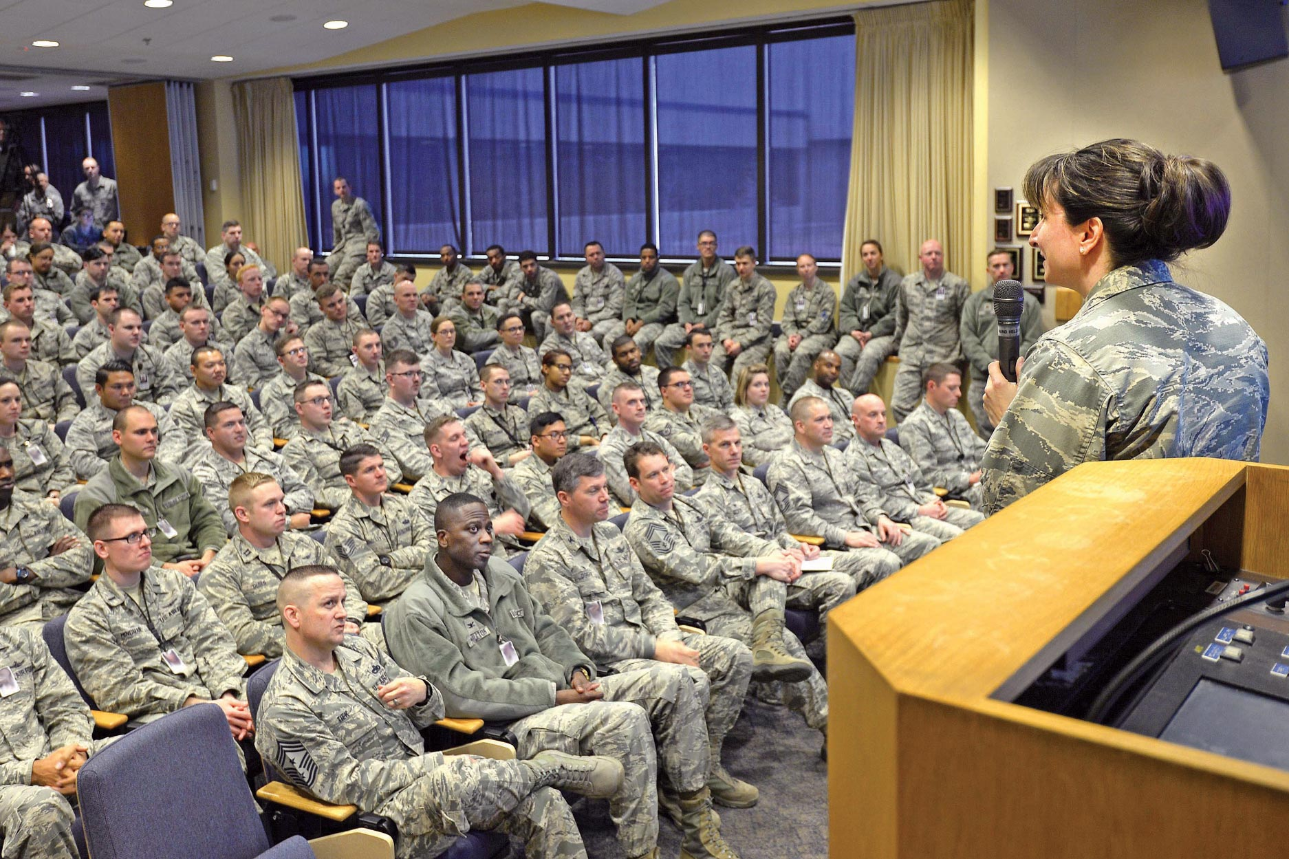 U.S. Air Force photo by Dennis Rogers Col. Jennifer Grant, 50th Space Wing commander, answers questions during an all-call at Schriever Air Force Base, Colorado, Jan. 10, 2018. Grant provided the opportunity for a question and answer segment, which encouraged Schriever members to speak up about matters important to them.