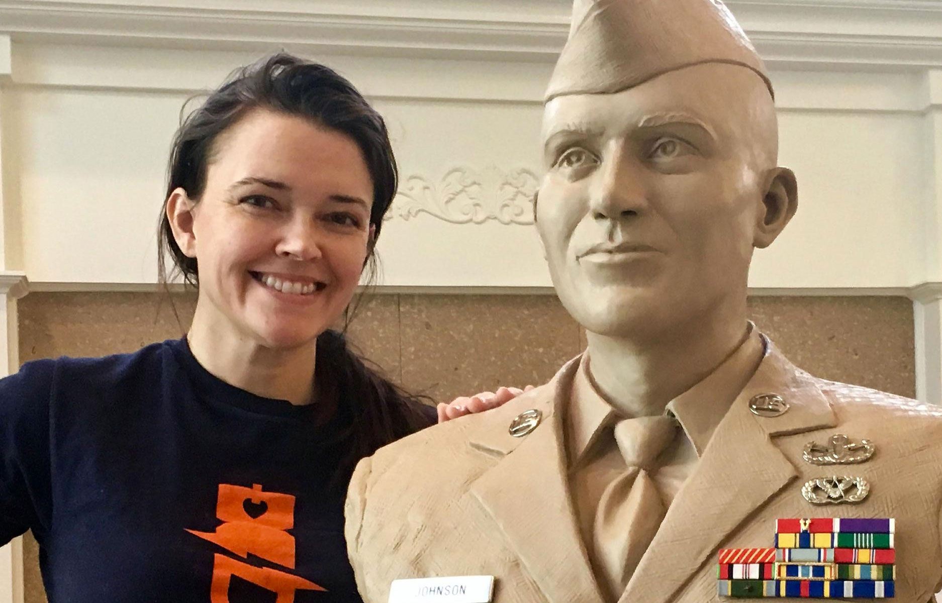 (U.S. Air Force photo by Senior Master Sgt. Stephen Hunter) LUKE AIR FORCE BASE, Ariz. (AFNS) — Stephanie Hunter, spouse of Senior Master Sgt. Stephen Hunter, 944th Civil Engineer Squadron explosive ordnance disposal technician program manager, stands beside a sculpted bust of Senior Airman Daniel Johnson, 30th Civil Engineer Squadron EOD technician. Stephanie created the scuplture as a memorial for Johnson who was killed in action Oct. 5, 2010 while serving during Operation Enduring Freedom.